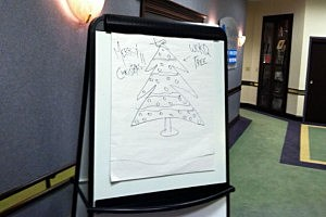 A drawing of Christmas Tree on a board