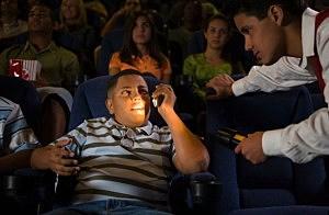 movie patron on phone